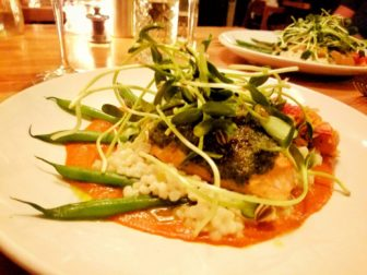 Fish dinner with vegetables at Watershed Restaurant