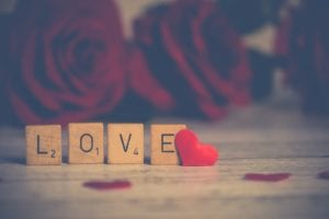 Scrabble letters spelling the word LOVE